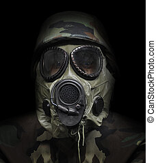 Gas Mask War Soldier on Black Background - A soldier is...