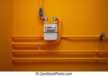 Gas-meter - Pipes and gas-meter on orange wall