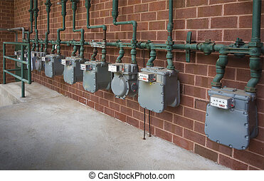 Commercial building gas meters close up with shallow depth of field