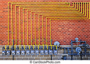 Gas meters on brick wall - Row of natural gas meters with ...