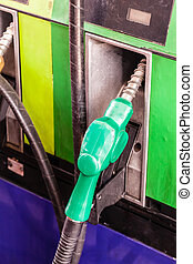 Gas nozzle - colored petrol gas pump nozzles in a service...
