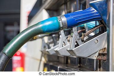gas pump nozzles closeup