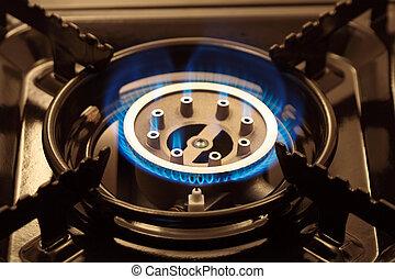 Gas Range - Closeup of black portable gas range with blue ...