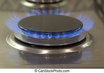 Gas Ring - blue flame on burner of stainless steel cooker