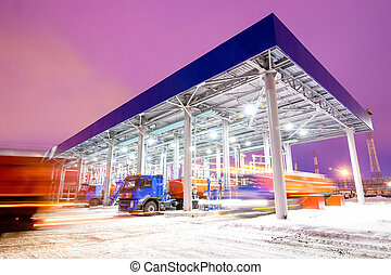gas station at oil refinery factory night time - gas station...