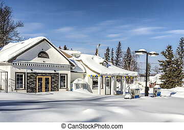 Gas Station in Winter - The fresh snow around a local gas...