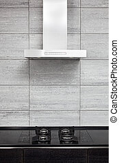 Gas-stove and cooking hood on modern minimalism style kitchen