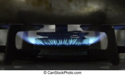 Gas stove blue flame that warms the kettle