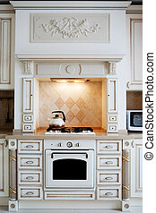 gas stove - kettle and gas cooker on modern kitchen