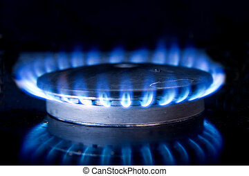 Gas Stove Top Fire - Circle of blue flame above gas top...