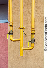 Gas valves on the pipe in an apartment house