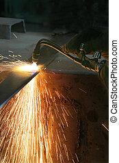 Gas welding of metal at a modern factory