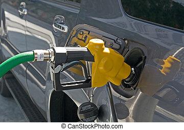 Gasoline Nozzle - A gasoline station filling nozzle in a gas...