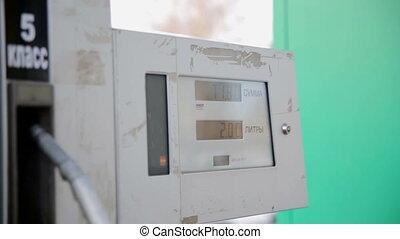 Gasoline or petrol station gas fuel pump nozzle.