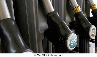 Gasoline or petrol station gas fuel pump nozzle. Filling...