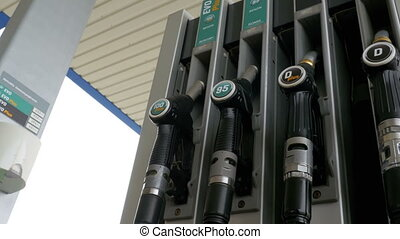 Gasoline or petrol station gas fuel pump nozzle. Filling...