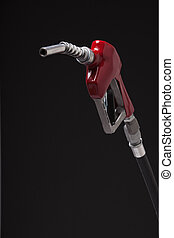 Gasoline pump nozzle with red vinyl covered handle isolated on black