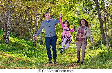 gastando, ao ar livre, família jovem, tempo
