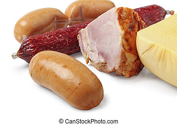 Gastronomic products: cheese, sausage, ham and sausages close-up isolated on a white background