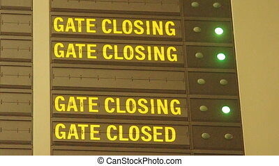 Gate closing message in airport - blinking gate closing...