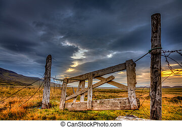Gate - Dilapidated gate on a farm in Iceland with dramatic...