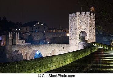 gate in medieval european town in night. Besalu, Catalonia