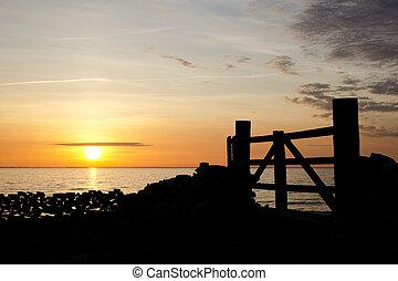 Gate in sunset