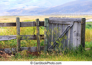 Gate is closed - Old, rustic, wooden gate is closed. It ...