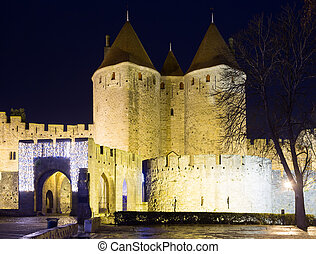 Gate of fortified city in night time. Carcassonne, France