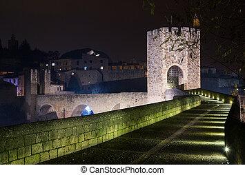 gate on bridge in night. Besalu, Catalonia