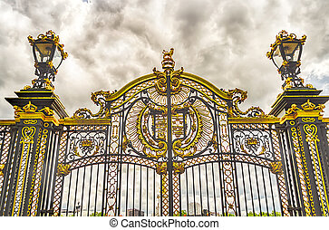 Gate with gilded ornaments in Buckingham Palace, London