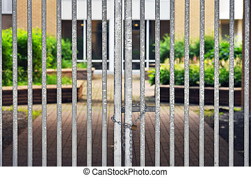 Gated residential community, locked fence with padlock and...