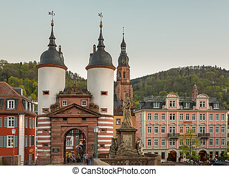HEIDELBERG, GERMANY - APRIL 24: Tourists and locals stroll through gateway into old town on 24 April 2013. The bridge was built in 1786