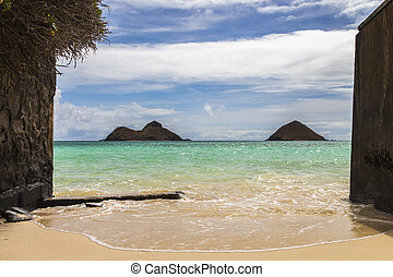 Gateway to Na Mokulua - A narrow beach opening with a view...
