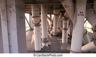 Gather of white tubes. Abstract columns and pipes outdoor.