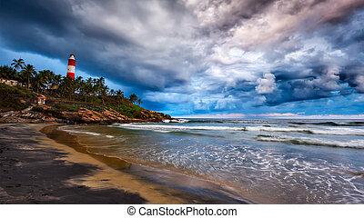 Gathering storm, beach, lighthouse. Kerala, India