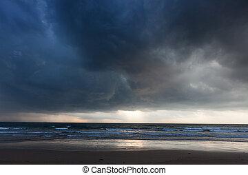 Gathering storm on beach