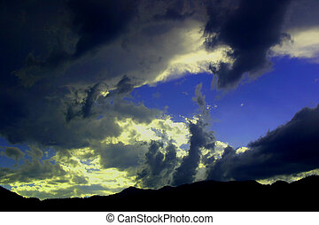 Gathering Storm - Storm clouds gather over the foothills as...