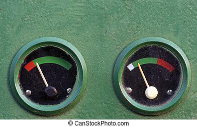 Two gauge meters on dashboard of vintage machine