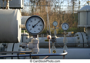 Gauges, tanks and tubes belonging to a control and...