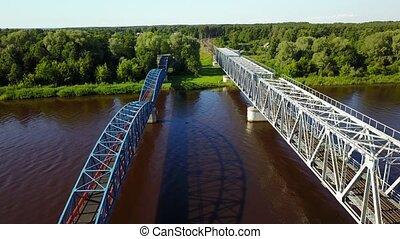 Gauja river railroad bridge Latvia aerial drone top view 4K...
