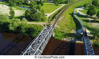 Gauja river railroad bridge Latvia aerial drone top view