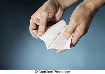 Gauze - Hands holding a sterile medical textile gauze...