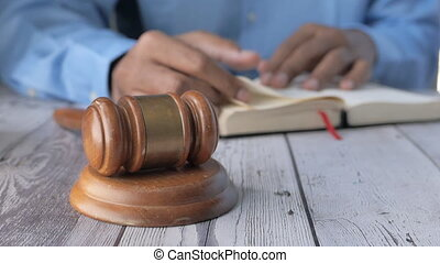 gavel and book on table .