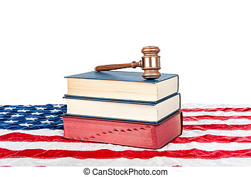 Gavel and books on American flag