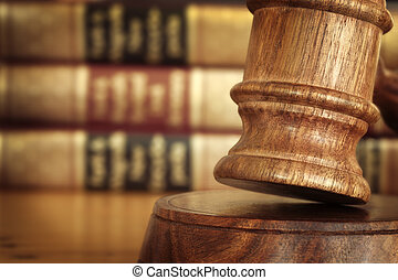 Gavel and Books - Gavel, with defocussed law books behind.