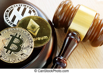 Gavel and cryptocurrency. Government regulation concept.