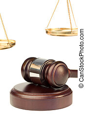 Gavel and golden scale of justice on a white background