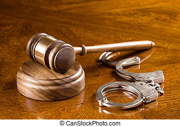 Gavel and handcuffs - A gavel and block on a richly colored...