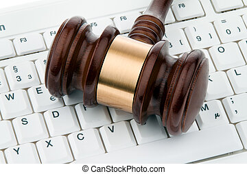 Gavel and keyboard. Legal security on the Internet